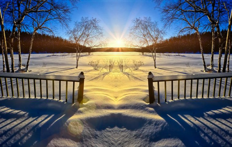 Vinterlandskap i solnedgång